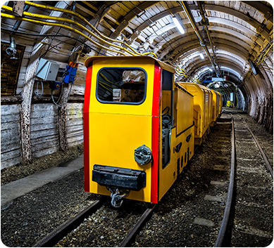 A carrier vehicle on tracks inside a tunnel